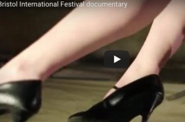 Someone's legs in black high heels