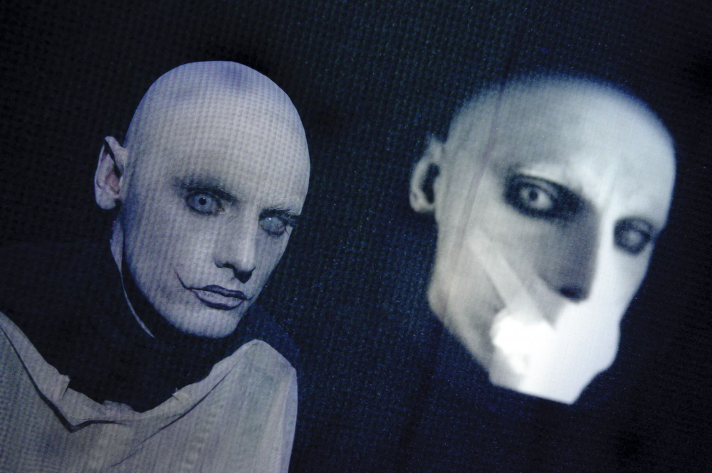 An abstract image of a man with a white painted face.