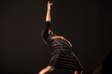 A male figure dances.
