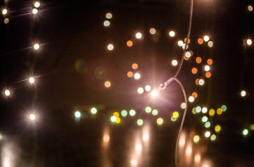 Warm fairy lights in a dark space.