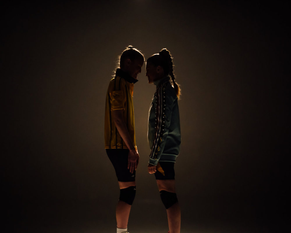 Two people stand facing each other