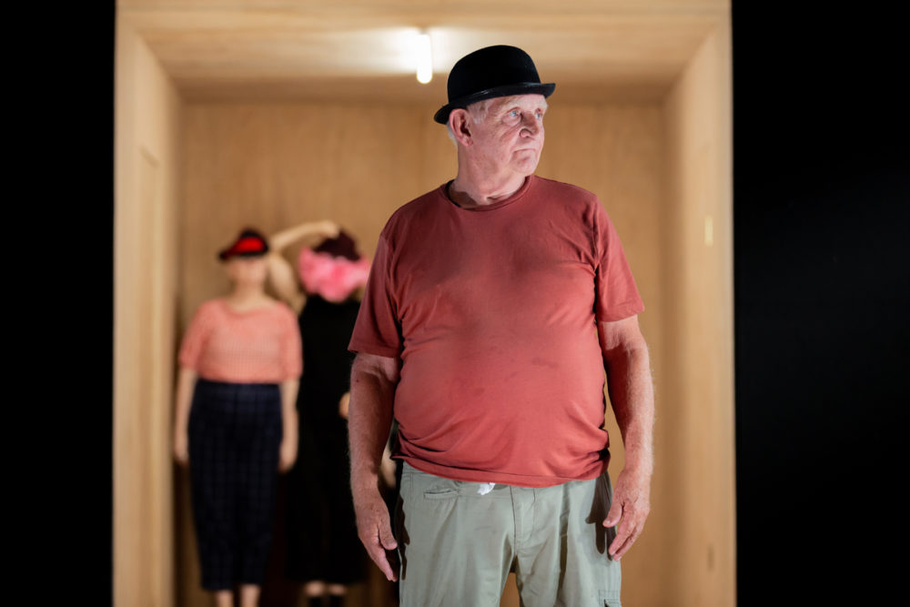 Man wearing black hat in small room