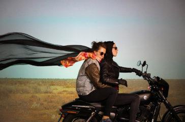 Two people ride on motorbike