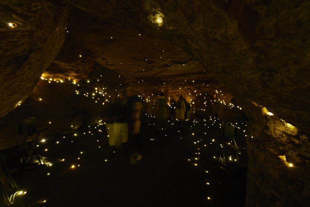 people explore the We Are Warriors installation in Redcliffe Caves